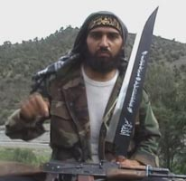 Shahab Dashti holding a large sword in a 2009 militant propaganda video.